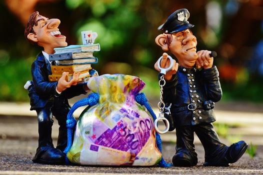 -taxes-tax-evasion-police-handcuffs-medium